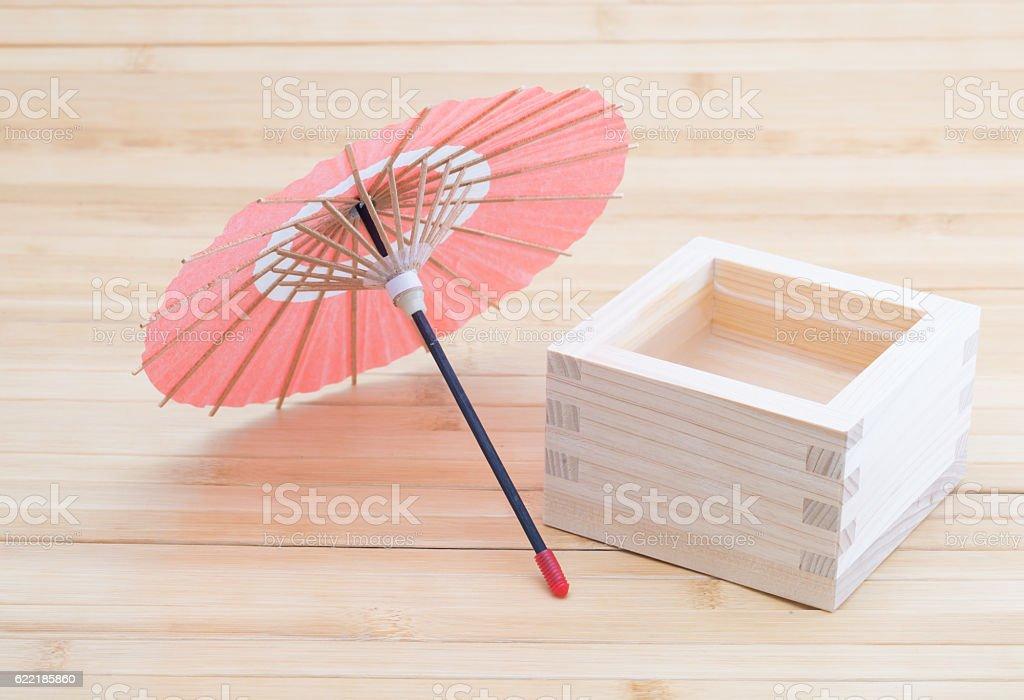 Sake and miniature of Japanese umbrella stock photo