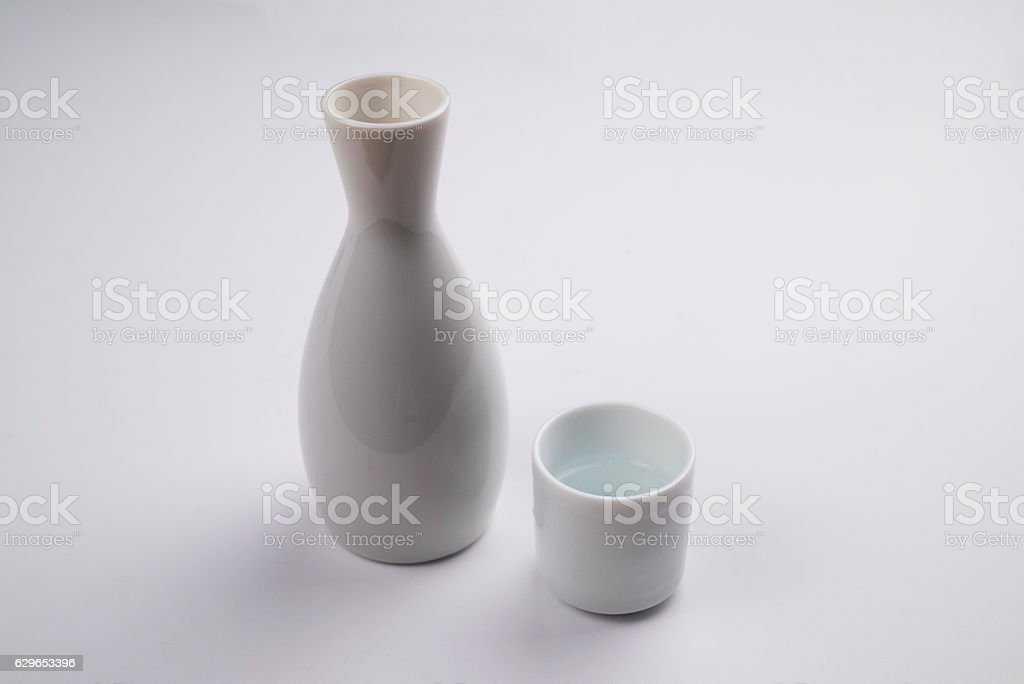 Sake bottle and cup on White stock photo