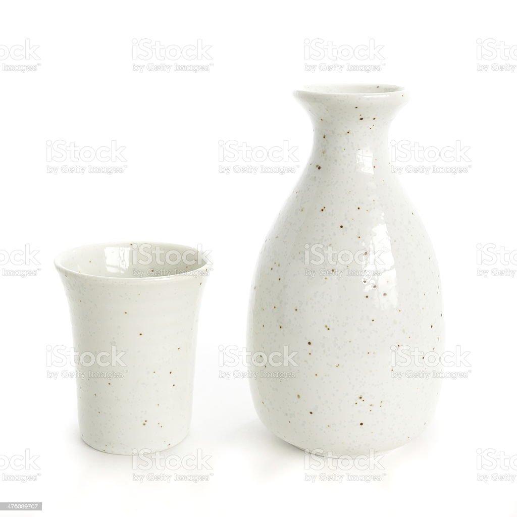 sake bottle and sake cup on white background stock photo