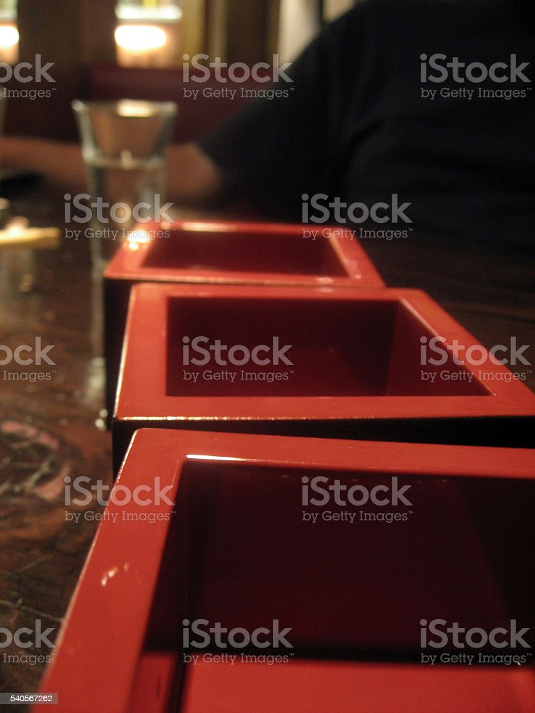 Sake cups on the table stock photo