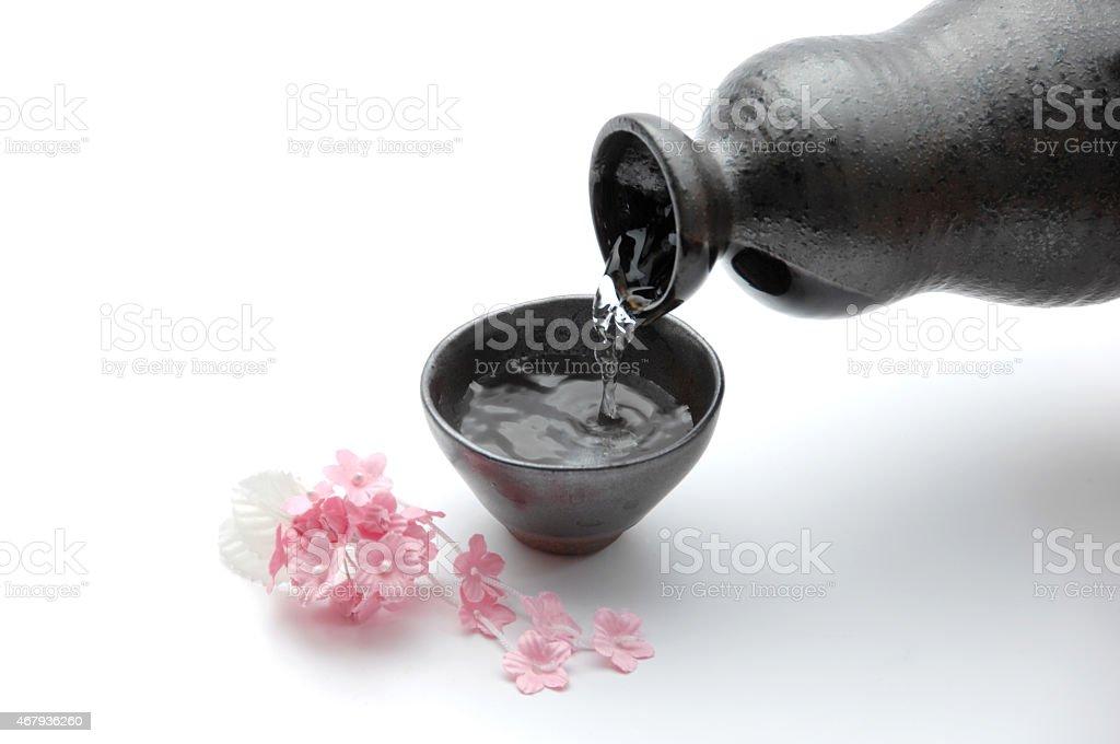 Sake, Japanese liquor with cherry blossoms stock photo