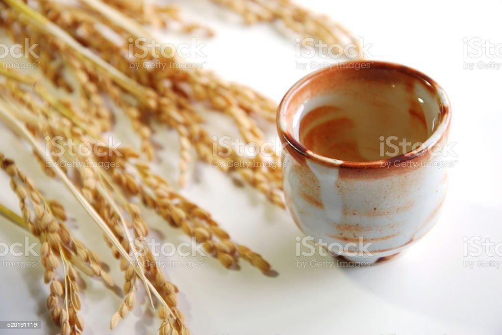 sake with rice stalks stock photo