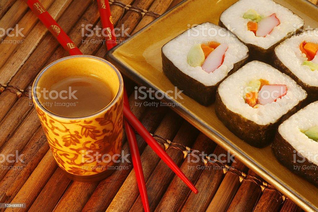 saki and sushi dinner stock photo
