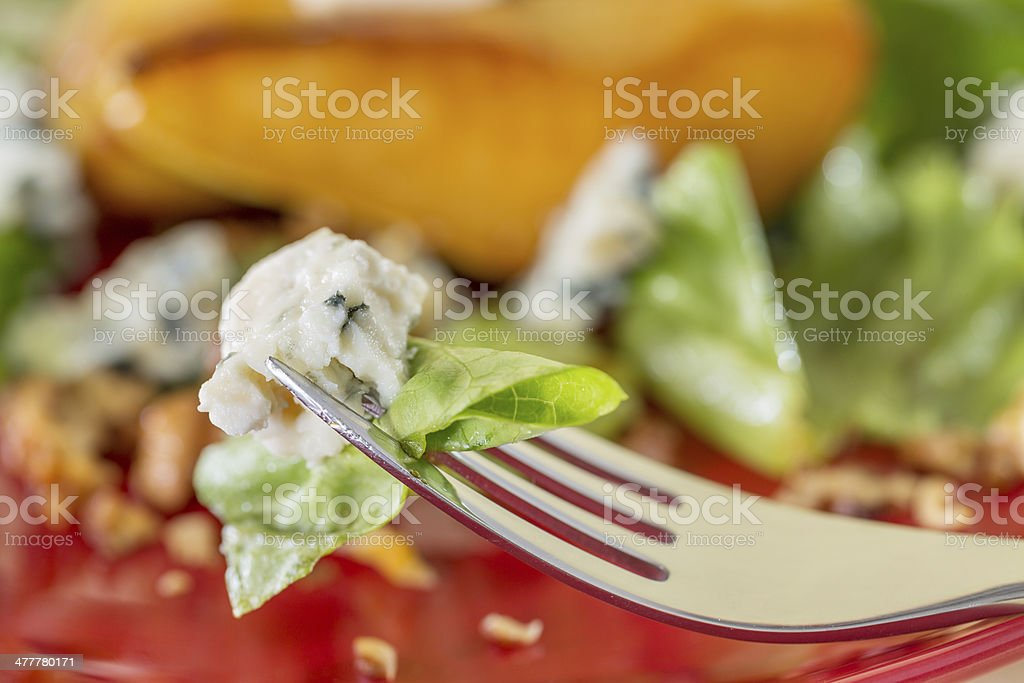 Salad and goat cheese on forks, close up royalty-free stock photo