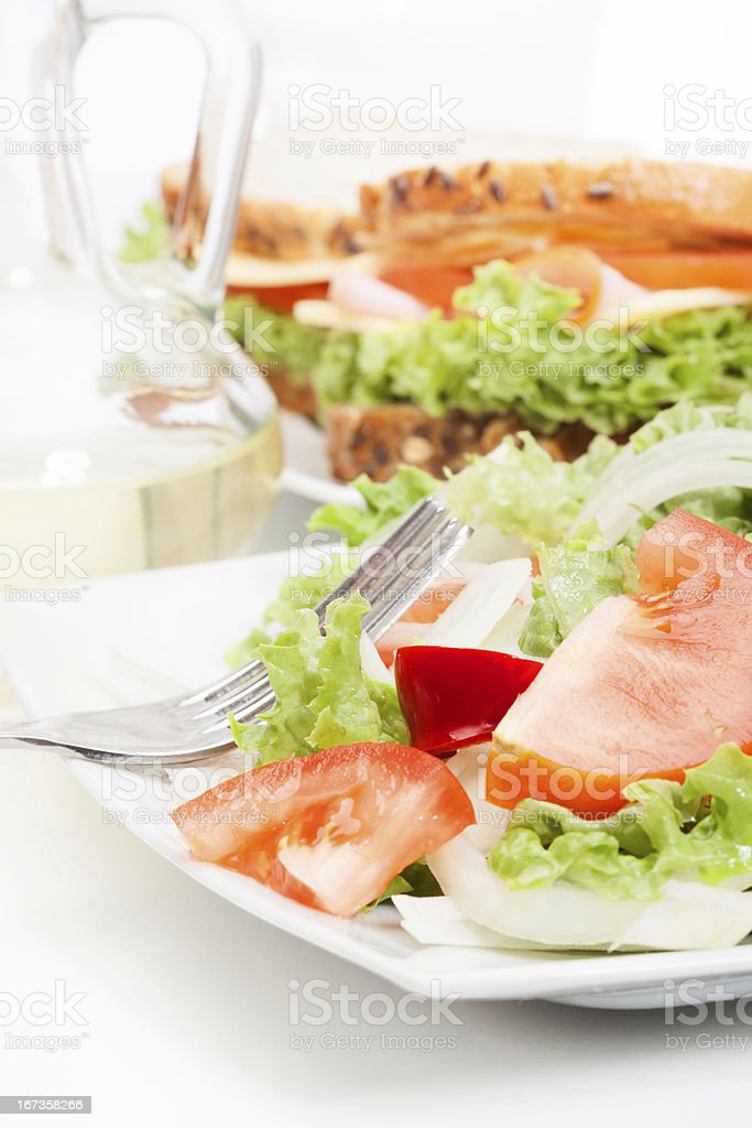 Salad and sandwiches stock photo