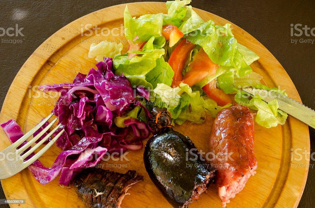 Salad and sausage stock photo