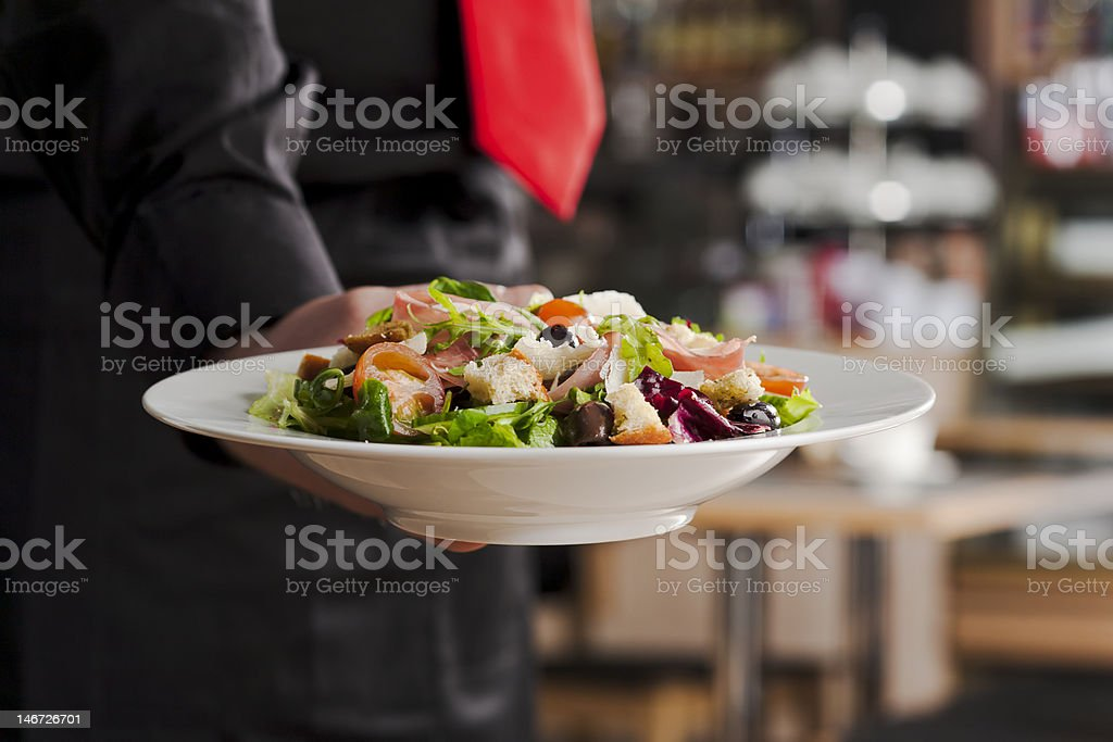 Salad and waiter royalty-free stock photo