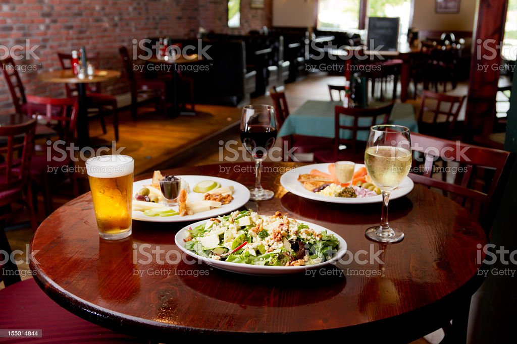 Salad, Appetizer Plates with Wine and Beer royalty-free stock photo