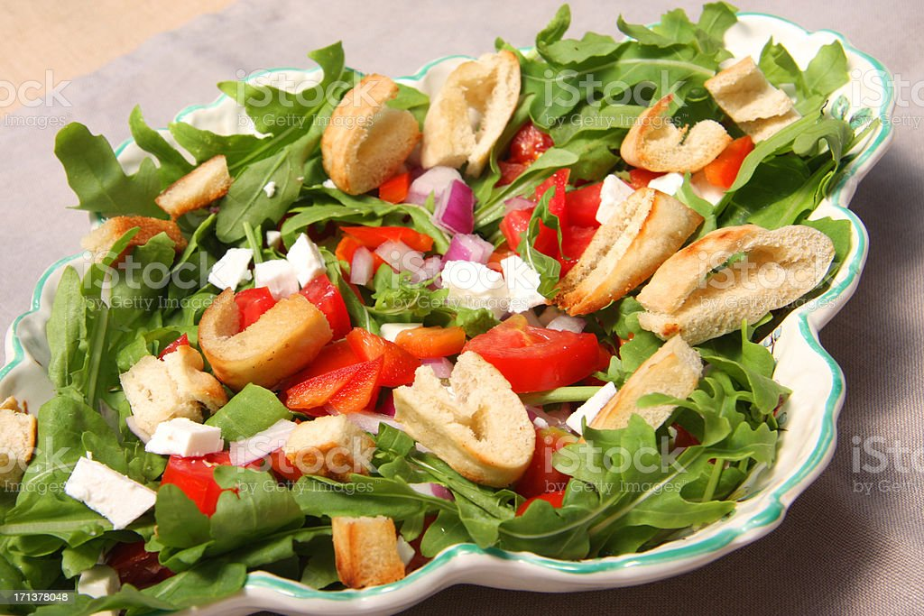 Salad arugula  with feta cheese and croutons from pita bread stock photo