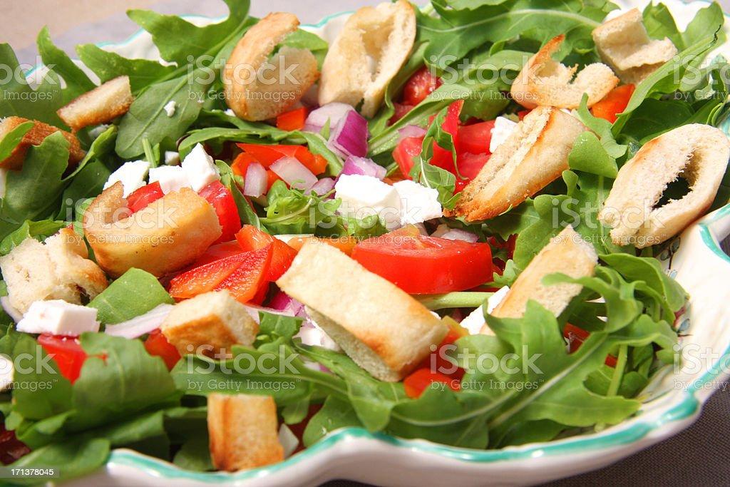 Salad arugula with feta cheese and pita bread croutons stock photo