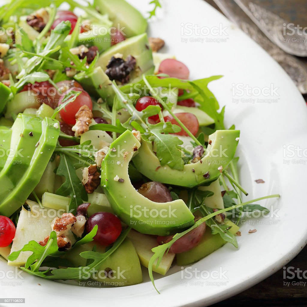 salad avocado with grapes and celery stock photo
