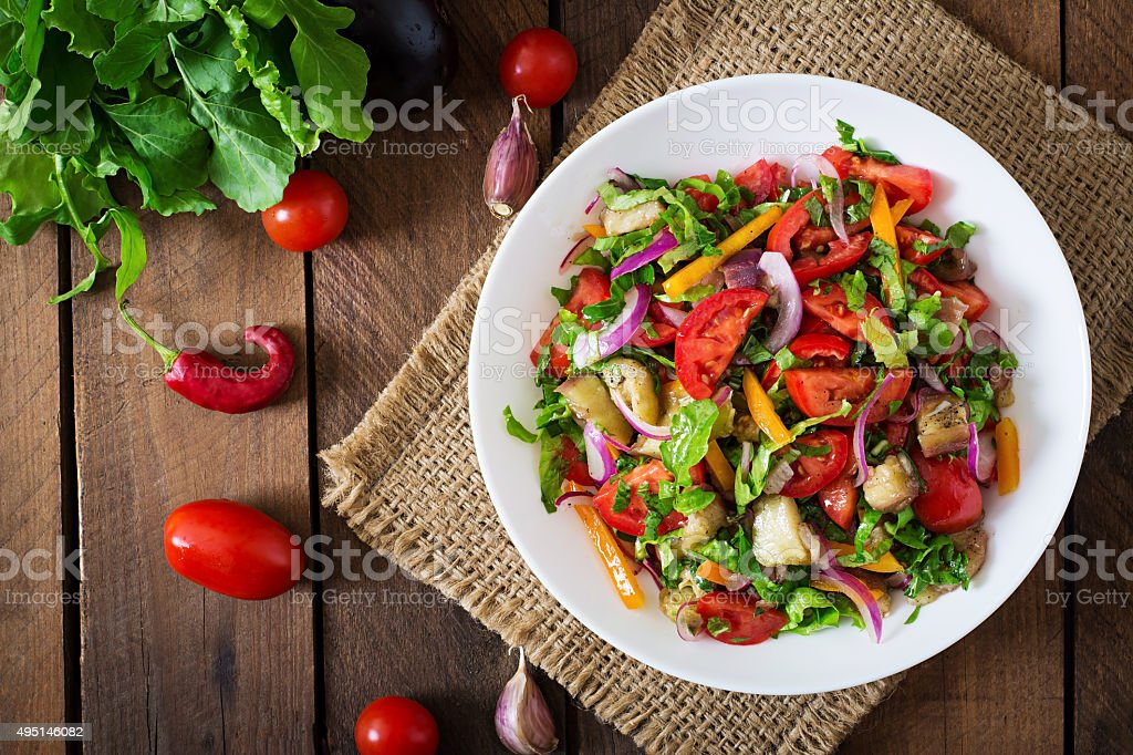 Salad baked eggplant and fresh tomatoes stock photo