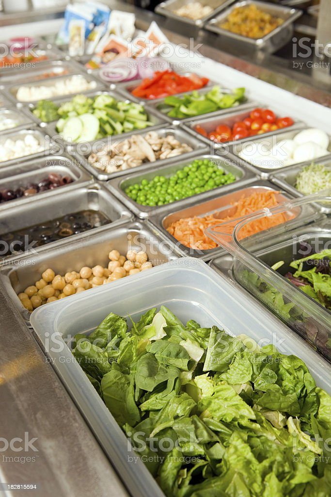 Salad Bar with Fresh Lettuce and Toppings stock photo