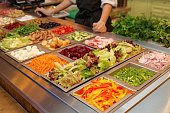 Salad bar with various fresh vegetables