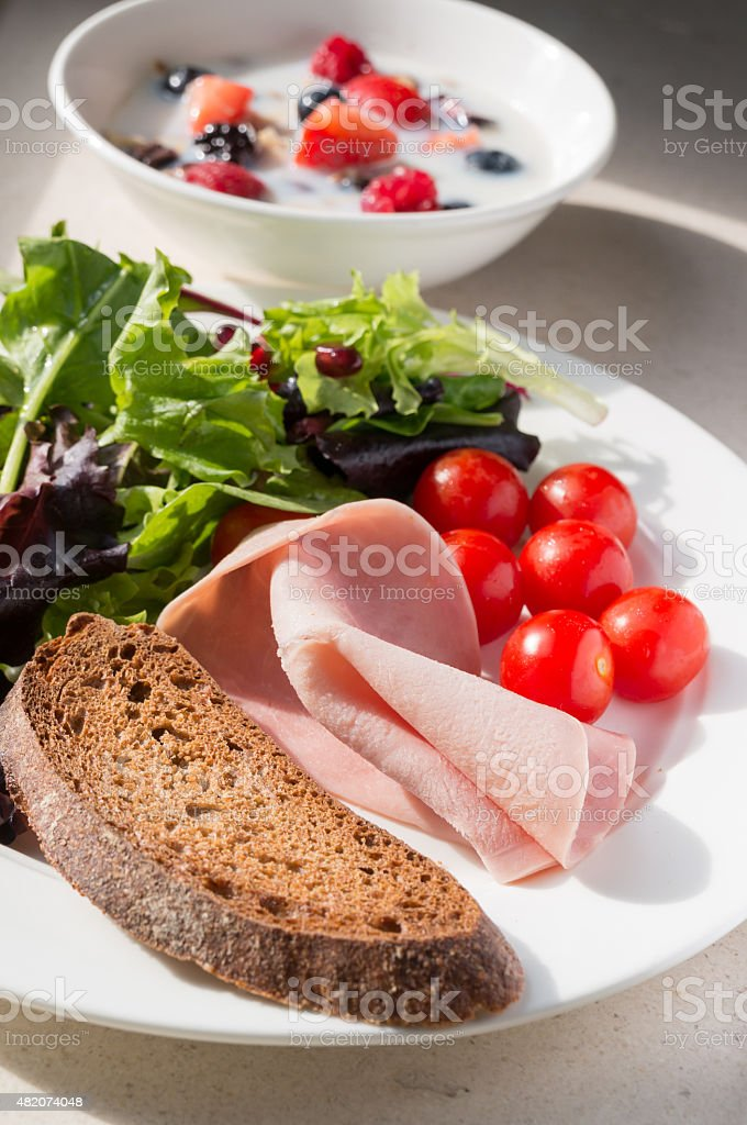 Salad breakfast with toast and berries cereal stock photo