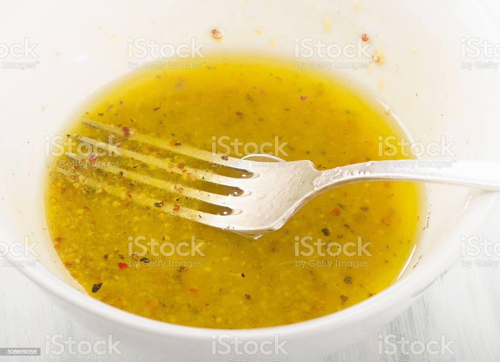 Salad dressing in a bowl. Selective focus. stock photo