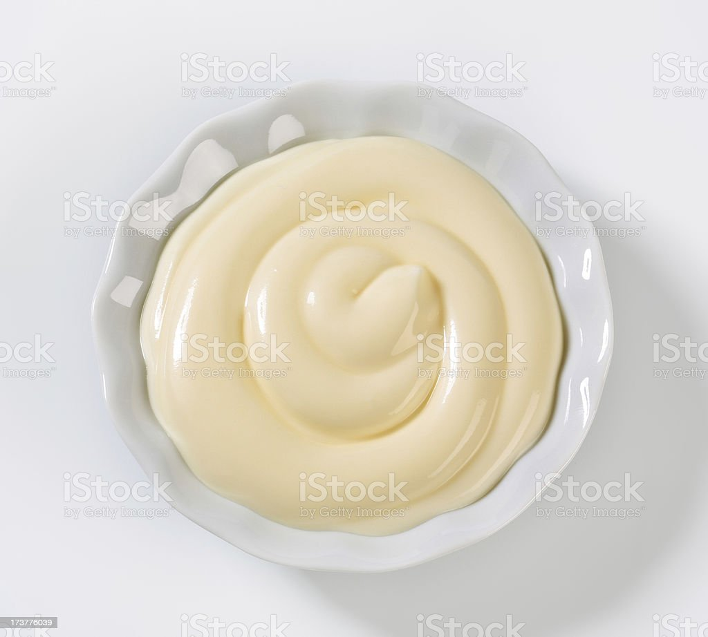 Salad dressing spread in bowl on white stock photo