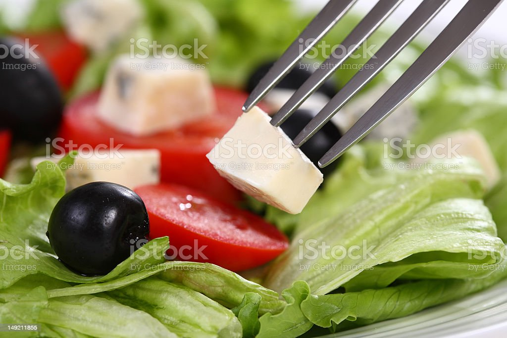 Salad - fresh lettuce, tomato, black olives and cheese royalty-free stock photo