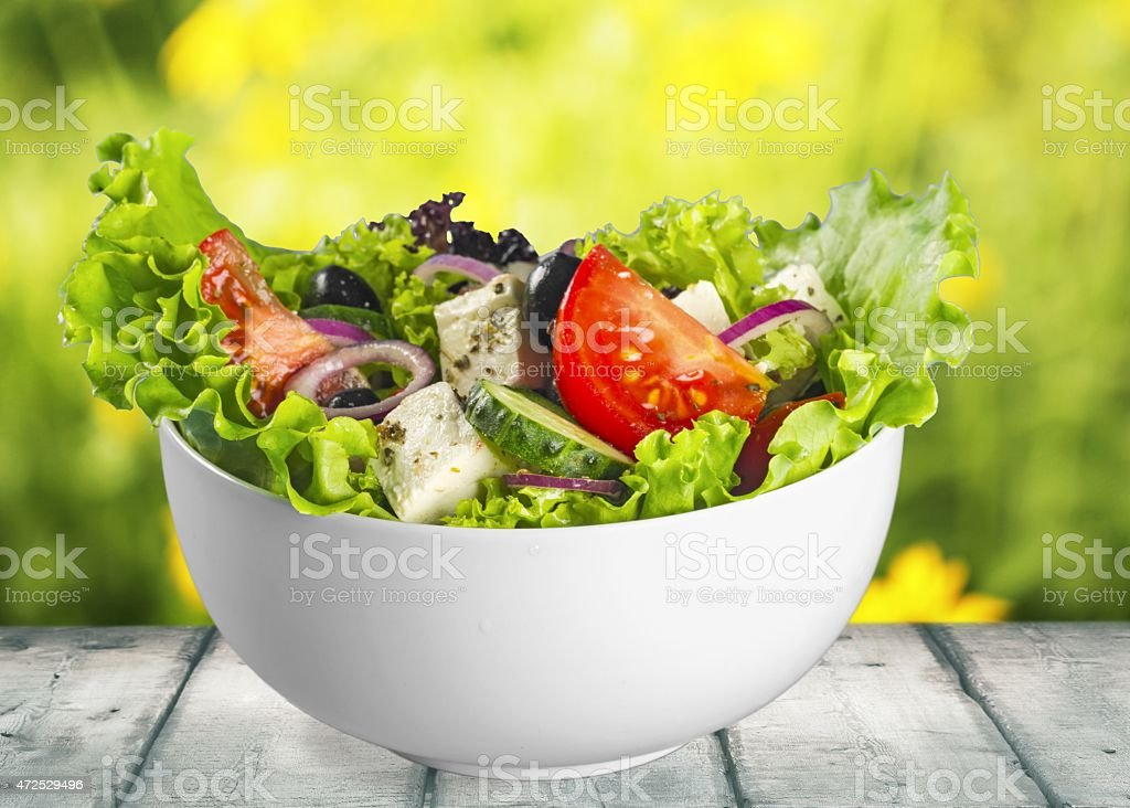 Salad. Fresh mixed vegetables salad in a bowl stock photo