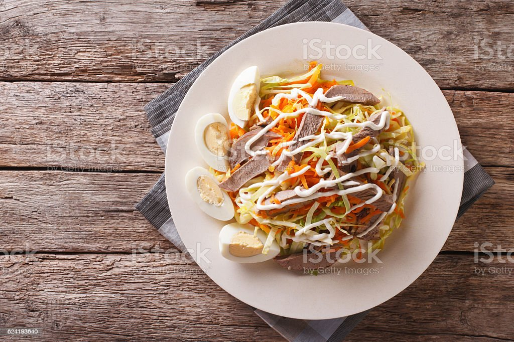 Salad from beef heart with eggs and vegetables. horizontal stock photo