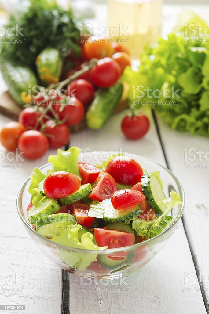 Salad from cherry tomatoes and cucumbers royalty-free stock photo