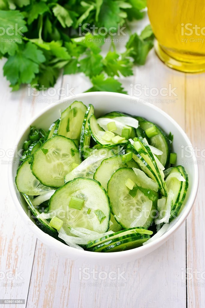 Salad from cucumber and parsley stock photo