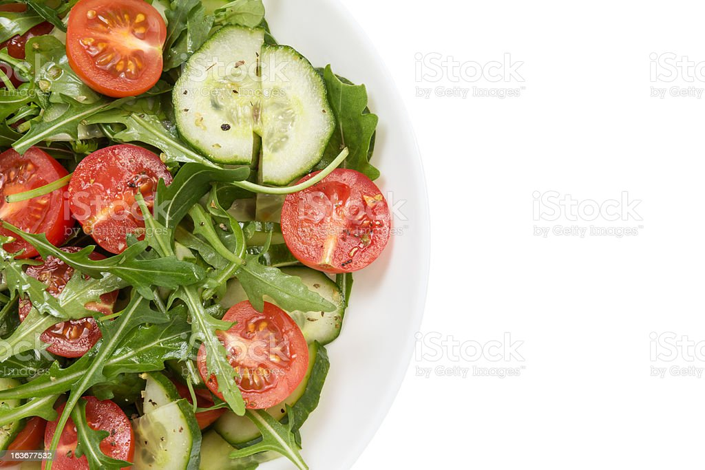 salad from ruccola, cherry tomatoes and cucumber royalty-free stock photo