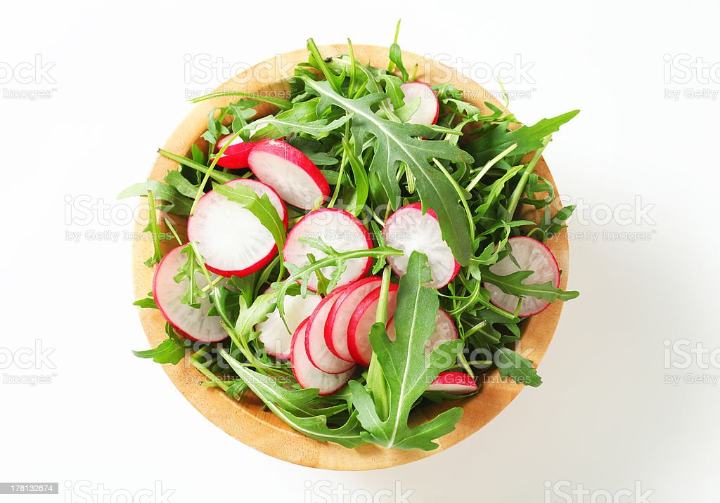 Salad greens with sliced radish stock photo