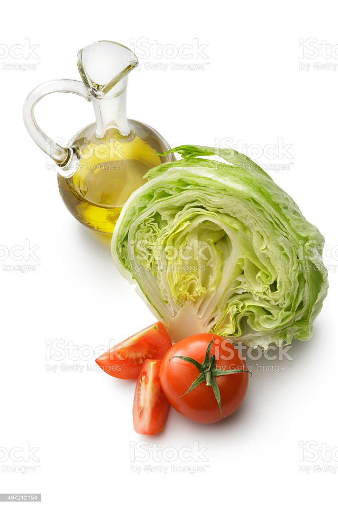 Salad Ingredients: Lettuce, Tomato and Oil stock photo