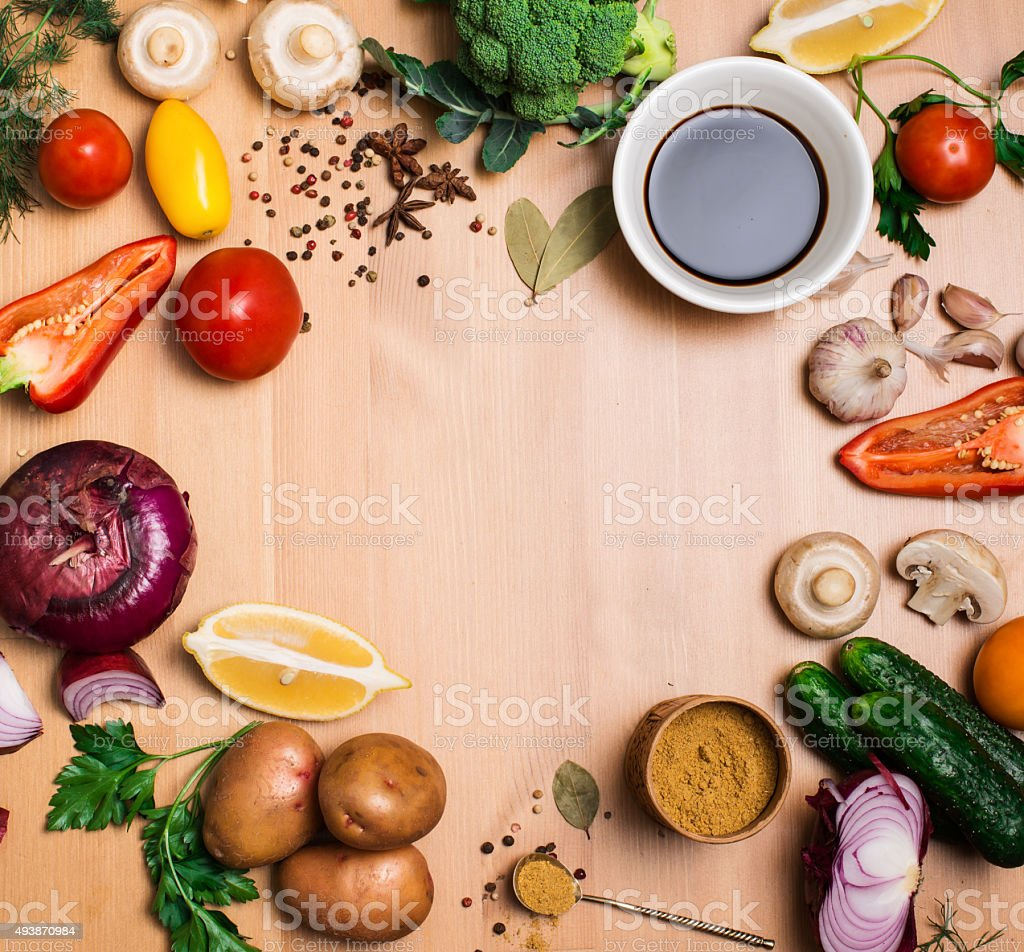 Salad ingredients on rustic wooden background with copy space. stock photo