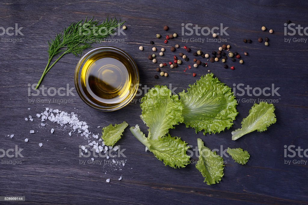 Salad ingredients over wooden table. stock photo
