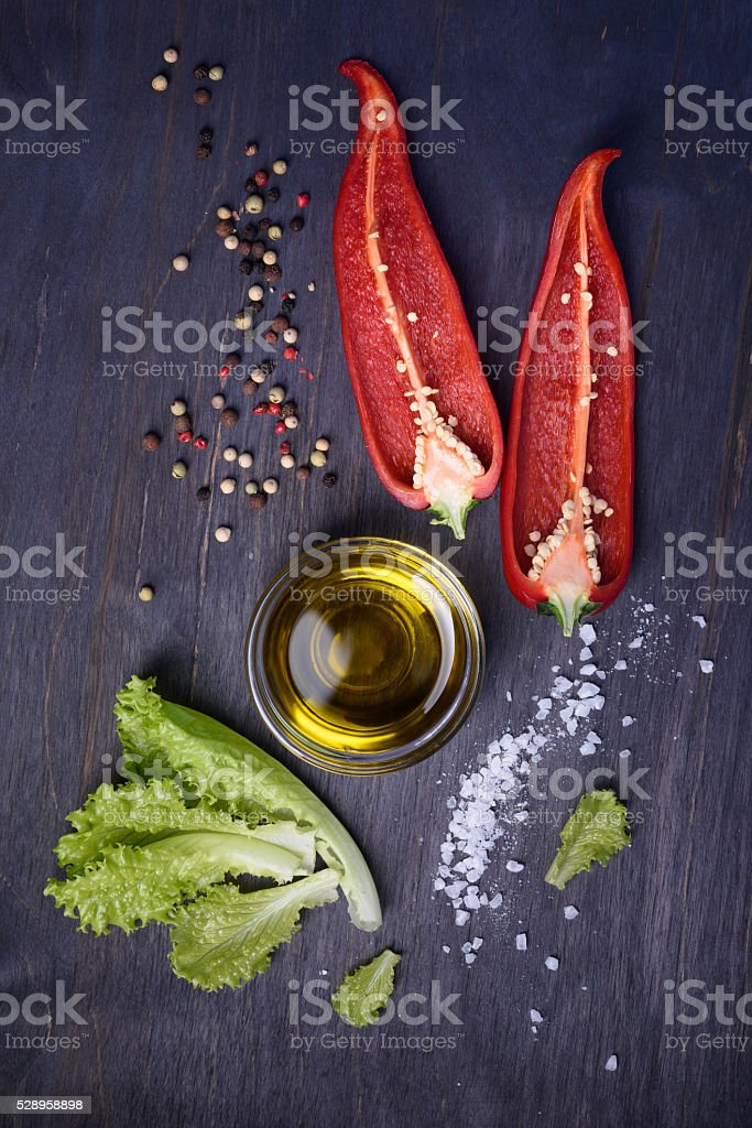 Salad ingredients - red pepper, lettuce, olive oil. stock photo