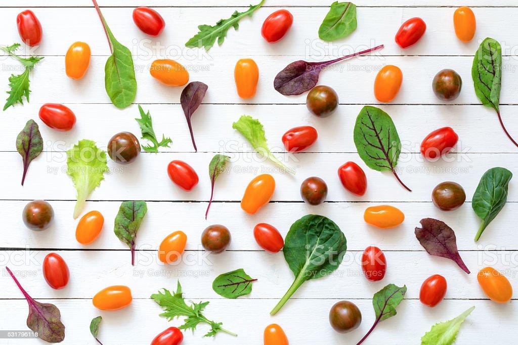 Salad leaf cherry tomato pattern on white background stock photo