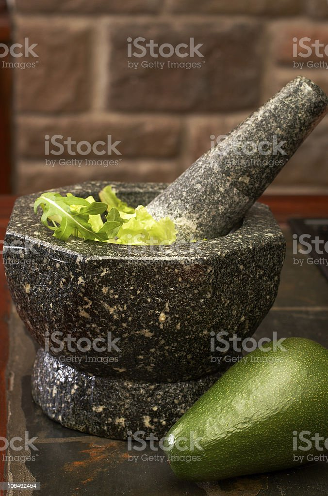 Salad leaves in the herb crusher royalty-free stock photo
