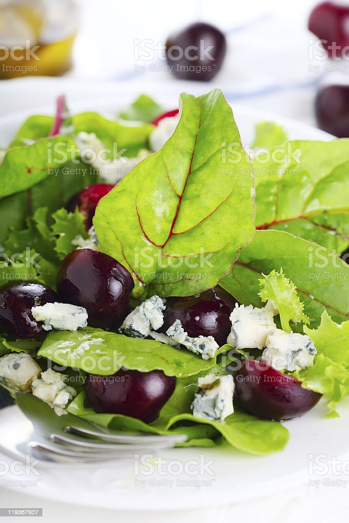 Salad mix with cherries and blue cheese stock photo