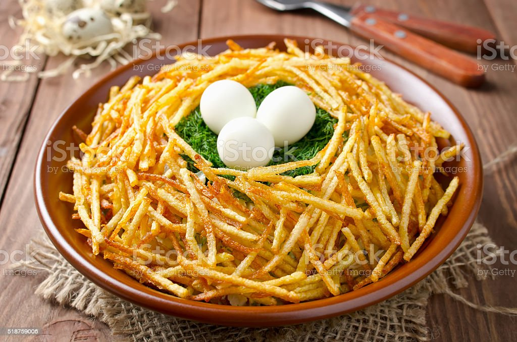 Salad 'Nest grouse'. Russian traditional salad stock photo