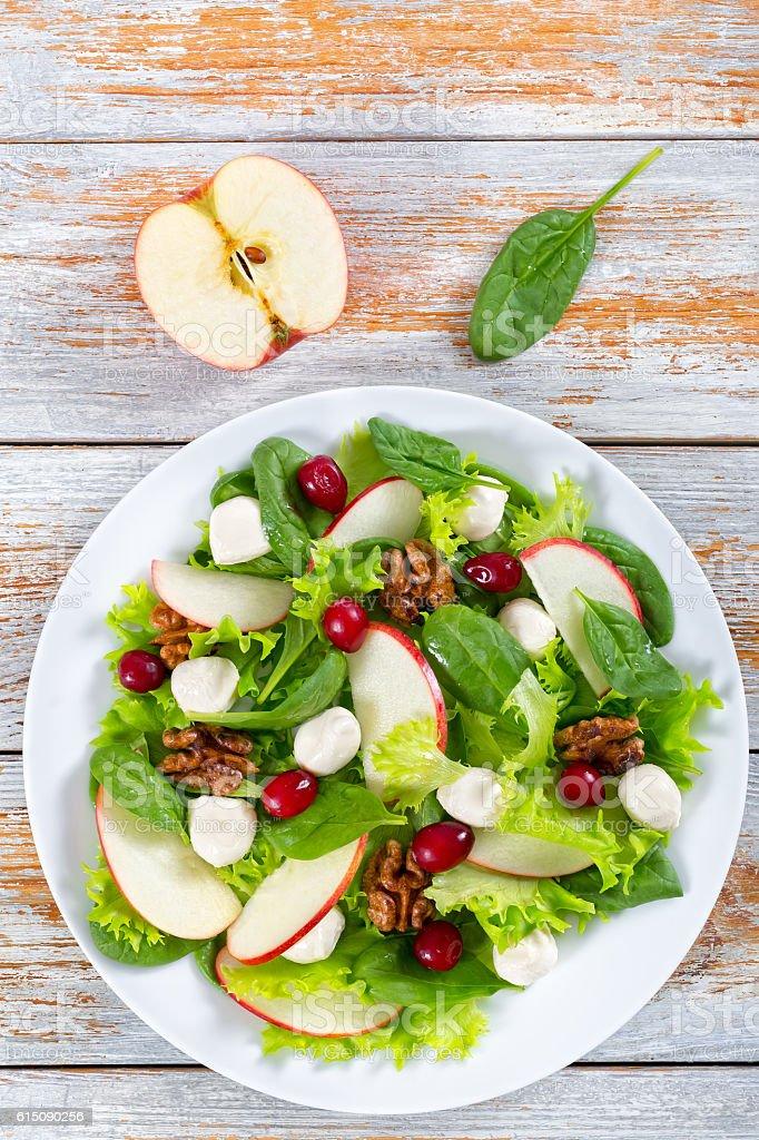 salad of apple, spinach, mini mozzarella balls, lettuce leaves, stock photo