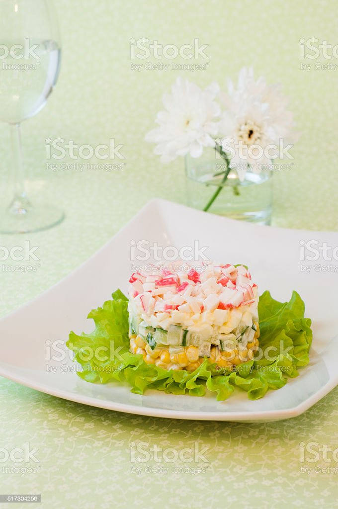 Salad of crab sticks and corn stock photo