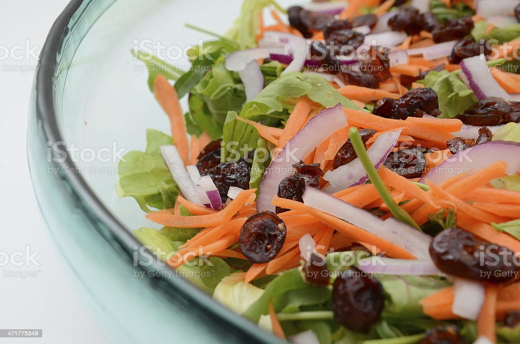 Salad of cranberry and carrot with baby leaves royalty-free stock photo