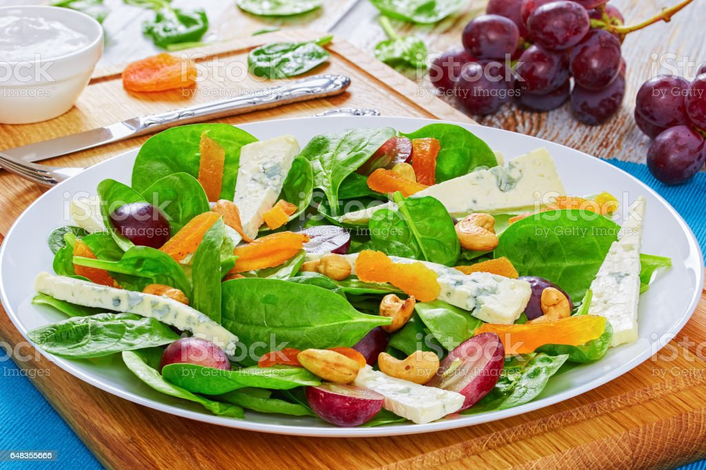 salad of fresh grapes, cheese, spinach stock photo