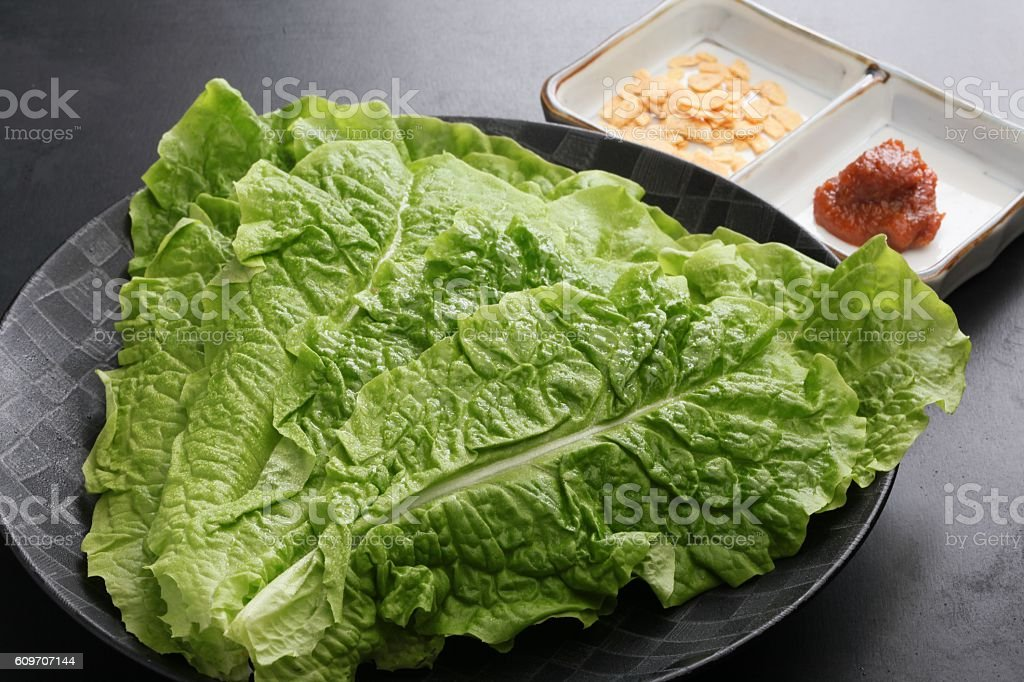 Salad of green fresh lettuce  with chili sauce on stock photo