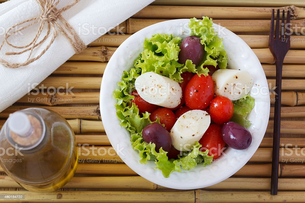Salad of heart of palm (palmito), cherry tomatos, olives, pepper stock photo