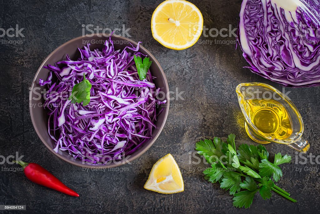 Salad of red cabbage and ingredients on a dark background stock photo