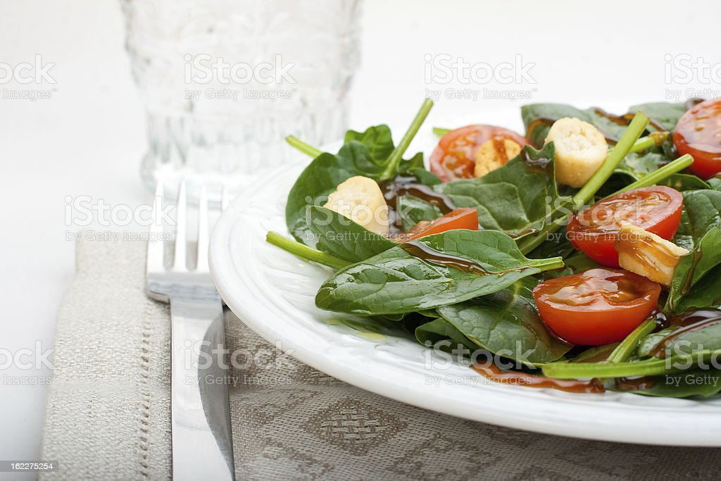 Salad of spinach  and tomato cherry. royalty-free stock photo