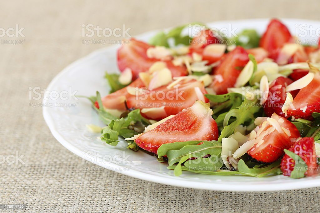 salad of strawberries, arugula and almonds royalty-free stock photo
