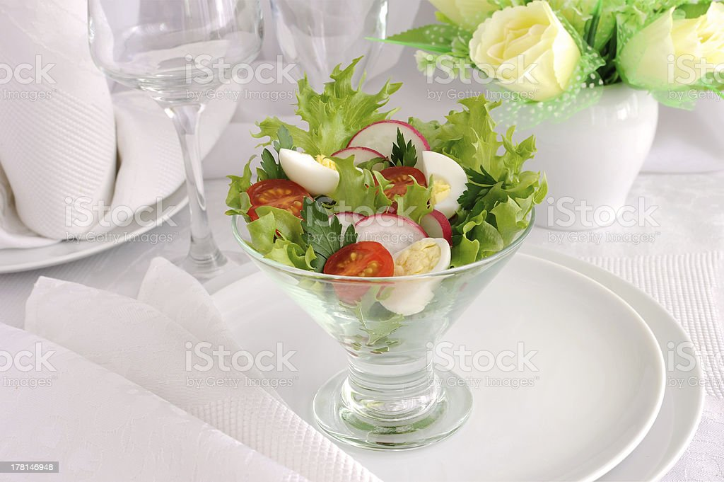 Salad of summer vegetables with quail eggs royalty-free stock photo