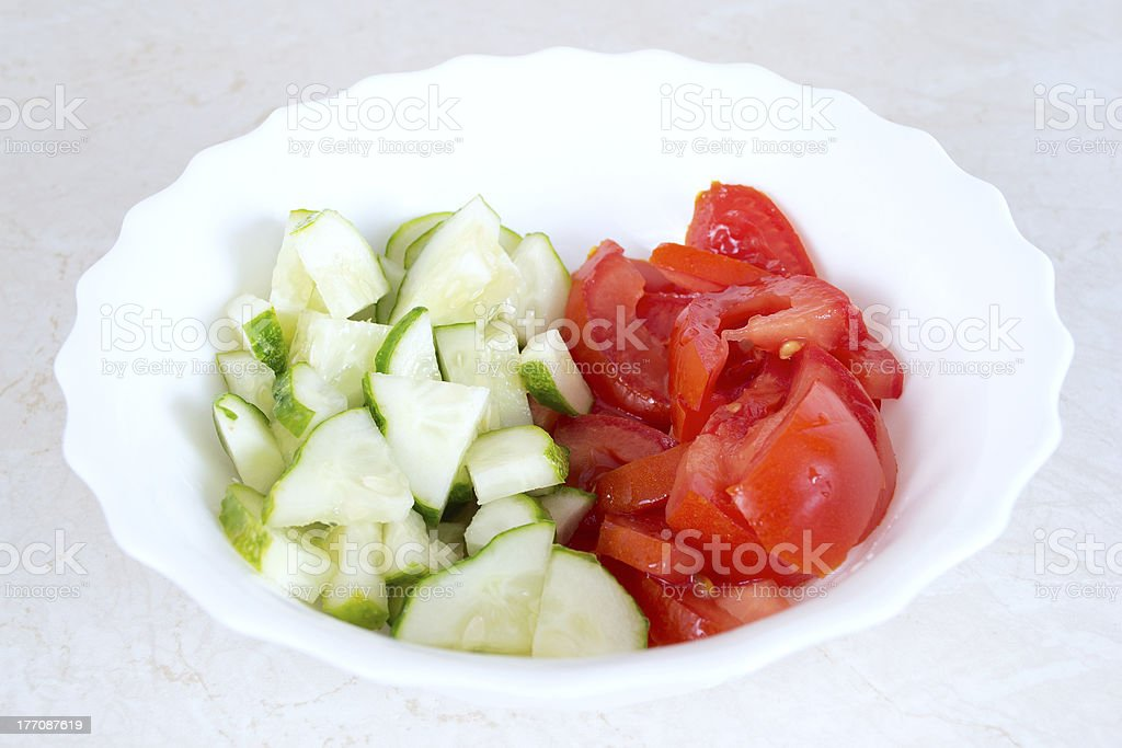 Salad of tomatoes and cucumbers in the bowl. stock photo