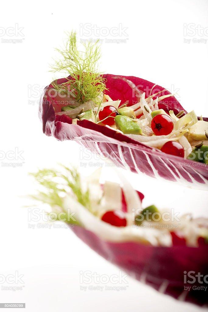 Salad on radicchio's boat royalty-free stock photo