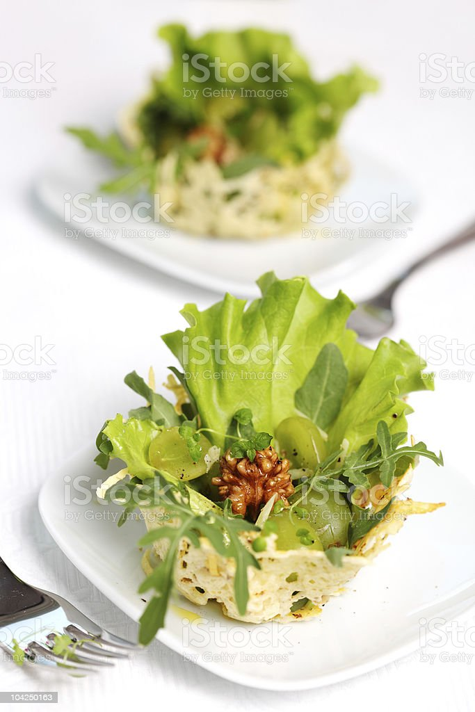 Salad- parmesan, walnut and arugula baskets stock photo