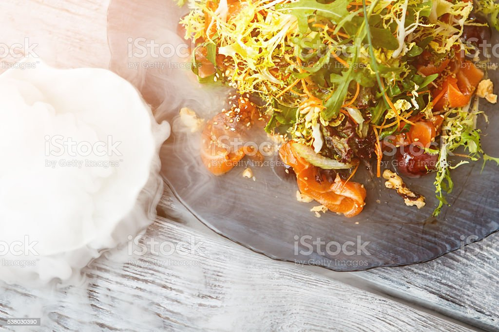 Salad plate and dry ice. stock photo